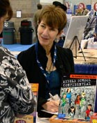 Parenting expert Annie Fox, M.Ed. signing one of her books